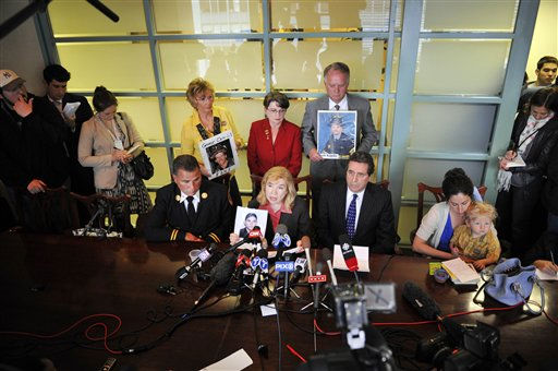 Families of some of the victims of the Sept. 11. 2001 terrorist attacks on the World Trade Center gather at a news conference as Sally Regenhard, mother of deceased firefighter Christian Regenhard, center seated, speaks about her reaction to the death of Osama Bin Laden. The others are, standing from left, Rosemary Cain, mother of firefighter George Cain and Russell and Joyce Mercer, parents of firefighter Scott Kopytko, Seated from left are retired NYFD Deputy Cheif Jim Richards, father of Jim Richards Jr.; Sally Regenhard; attorney Norman Seigel and Rosalie Tallon with son Paddy, sister of Sean Tallon.  &#40;AP Photo&#47;Stephen Chernin&#41; <span class=meta>(AP Photo&#47; Stephen Chernin)</span>