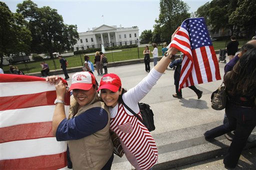 Nuri Vitiello, left, and Irene Fisher, both of Fairfax, Va., hold an American flag that they brought outside of the White House in Washington, Monday, May 2, 2011, the day after Osama bin Laden was killed. &#40;AP Photo&#47;Jacquelyn Martin&#41; <span class=meta>(AP Photo&#47; Jacquelyn Martin)</span>
