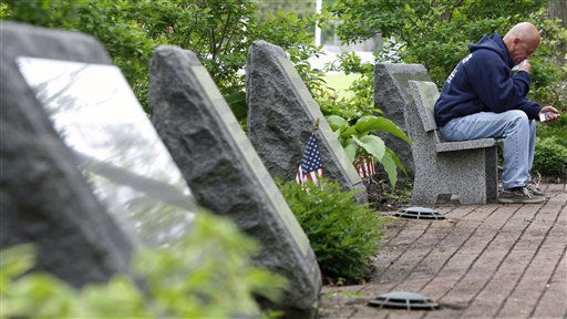Michael McKee pauses Monday, May 2, 2011, in Middletown, N.J., as he sits among some of the 37 carved stone memorials in a garden that honors those from the town that died in the attacks on the World Trade Center  Sept. 11, 2001. Word came late Sunday, May 1, 2011 the Osama Bin Laden has been killed. &#40;AP Photo&#47;Mel Evans&#41; <span class=meta>(AP Photo&#47; Mel Evans)</span>