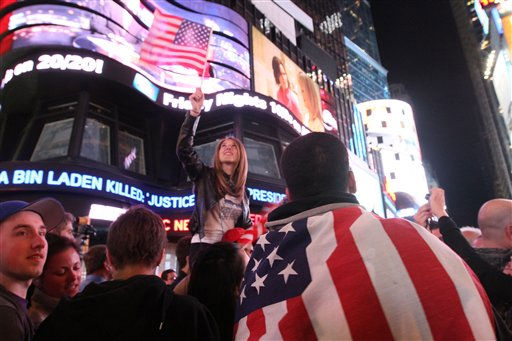 "<div class=""meta ""><span class=""caption-text "">Draped in the American flag, Pedro Valerio, of Elizabeth, N.J., right, and others in New York's Times Square react to the news of Osama Bin Laden's death early Monday morning May 2, 2011. (AP Photo/Tina Fineberg) (AP Photo/ Tina Fineberg)</span></div>"