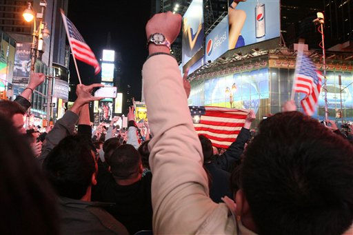 "<div class=""meta ""><span class=""caption-text "">People in New York's Times Square react to the news of Osama Bin Laden's death early Monday morning May 2, 2011. President Barack Obama announced Sunday night, May 1, 2011, that Osama bin Laden was killed in an operation led by the United States.(AP Photo/Tina Fineberg) (AP Photo/ Tina Fineberg)</span></div>"