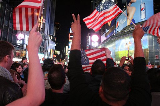 A crowd in New York&#39;s Times Square reacts to the news of Osama Bin Laden&#39;s death early Monday morning May 2, 2011. President Barack Obama announced Sunday night, May 1, 2011, that Osama bin Laden was killed in an operation led by the United States.  &#40;AP Photo&#47;Tina Fineberg&#41; <span class=meta>(AP Photo&#47; Tina Fineberg)</span>