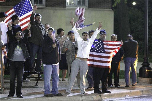 "<div class=""meta ""><span class=""caption-text "">Arab Americans celebrate the news of the death of Osama Bin Laden in Dearborn, Mich., early Monday, May 2, 2011.  President Barack Obama announced Sunday night, May 1, 2011, that Osama bin Laden was killed in an operation led by the United States. (AP Photo/Carlos Osorio) (AP Photo/ Carlos Osorio)</span></div>"