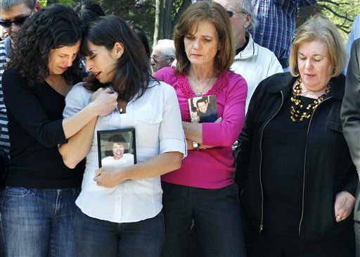 Massachusetts family members, from left, sisters Danielle and Carie Lemack who lost their mother Judy Larocque; Christy Coombs who lost her husband Jeffrey; and Irene Ross who lost her brother Richard Ross, all on ill-fated Flight 11 from Logan Airport on 9&#47;11 grieve in Boston Monday, May 2, 2011 during a moment of silence at the Garden of Remembrance, a memorial dedicated to the 206 Massachusetts victims of September 11, 2001. The event was held in the wake of news of the death of Osama bin Laden. &#40;AP Photo&#47;Elise Amendola&#41; <span class=meta>(AP Photo&#47; Elise Amendola)</span>