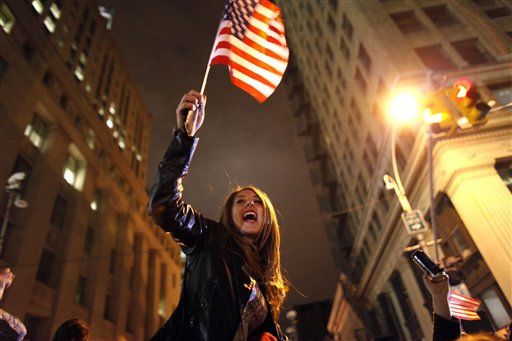 A large, jubilant crowd reacts to the news of Osama Bin Laden&#39;s death at the corner of Church and Vesey Streets, adjacent to ground zero, during the early morning hours of Tuesday, May 2, 2011 in New York. &#40;AP Photo&#47;Jason DeCrow&#41; <span class=meta>(AP Photo&#47; Jason DeCrow)</span>