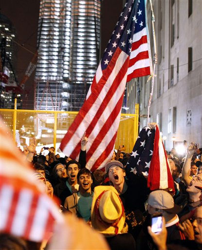 With the new One World Trade Center building in the background at left, a large, jubilant crowd reacts to the news of Osama Bin Laden&#39;s death at the corner of Church and Vesey Streets, adjacent to ground zero, during the early morning hours of Tuesday, May 2, 2011 in New York. &#40;AP Photo&#47;Jason DeCrow&#41; <span class=meta>(AP Photo&#47; Jason DeCrow)</span>