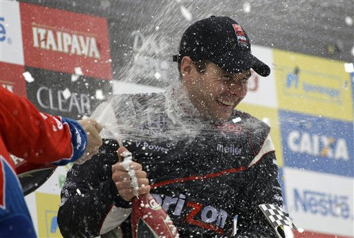 IndyCar driver Will Power of Australia celebrates his victory in the Sao Paulo IndyCar 300 in Sao Paulo, Brazil, Monday May 2, 2011. It was his second win in four races this season, giving him the points lead going into the Indy 500 later this month. Power, who started from pole position, drove to victory for Penske after Japan&#39;s Takuma Sato had to pit for fuel.  &#40;AP Photo&#47;Nelson Antoine&#41; <span class=meta>(AP Photo&#47; Nelson Antoine)</span>