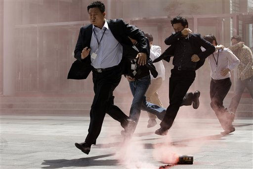 South Korean workers run to escape from a mock attack during an anti-terrorism exercise in Seoul, South Korea, Tuesday, May 3, 2011. Local police, fire, medical and military groups practiced drills ranging from fire to terror attacks and earthquake. &#40;AP Photo&#47; Lee Jin-man&#41; <span class=meta>(AP Photo&#47; Lee Jin-man)</span>