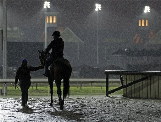 A horse is lead onto the track for a workout in the rain at Churchill Downs Tuesday, May 3, 2011, in Louisville, Ky. &#40;AP Photo&#47;Charlie Riedel&#41; <span class=meta>(AP Photo&#47; Charlie Riedel)</span>