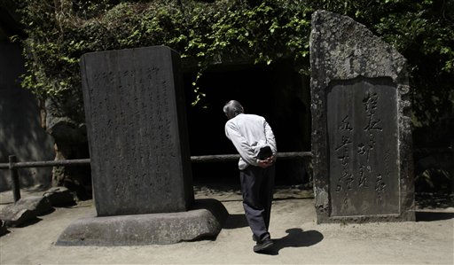 An elderly man reads a scripts carved on stones at Zuiganji temple in Matsushima, Miyagi Prefecture, northeastern Japan, Wednesday, May 4, 2011. Matsushima, known as one of Japan&#39;s three most famous views, survived a massive destruction from the March 11 earthquake and tsunami, resume tourism, starting from the country&#39;s long holiday, the Golden Week. &#40;AP Photo&#47;Junji Kurokawa&#41; <span class=meta>(AP Photo&#47; Junji Kurokawa)</span>