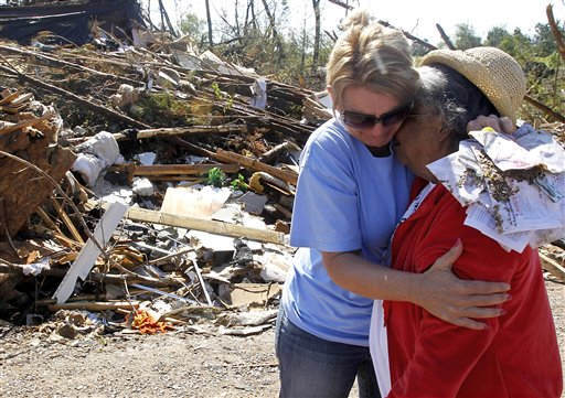 Nenia Cagle, left, consoles Annie Muse as she cries after finding the purse of her daughter in the rubble Wednesday, May 4, 2011, in Argo, Ala. A tornado ripped through the Argo area last Wednesday, killing Muse&#39;s sister and putting her daughter and another grandson in the hospital. &#40;AP Photo&#47;Butch Dill&#41; <span class=meta>(AP Photo&#47; Butch Dill)</span>