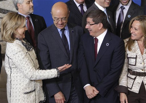 "<div class=""meta ""><span class=""caption-text "">From left, U.S. Secretary of State Hillary Rodham Clinton, French Foreign minister Alain Marie Juppe', Turkish Minister of Foreign Affairs, Ahmet Davutoglu, and Spanish minister of Foreign Affairs  Trinidad Jiménez García-Herrera, during a diplomatic meeting on how to support rebels fighting the Libyan leader Moammar Gadhafi, at Rome's Foreign Ministry, Thursday, May 5, 2011. The meeting of 22 nations and some international organizations also included the NATO chief, the Arab League, the leader of Libya's opposition council, Mustafa Abdel-Jalil, who used to be Gadhafi's justice minister.  (AP Photo/Pier Paolo Cito) (AP Photo/ Pier Paolo Cito)</span></div>"