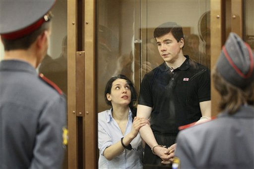 "<div class=""meta ""><span class=""caption-text "">Nikita Tikhonov, background right, and Yevgenia Khasis, left, listen to a court sentence from behind glass at a Moscow court on Friday, May 6, 2011. The Moscow City Court on Friday sentenced 31-year-old nationalist Nikita Tikhonov to life in prison and his 26-year-old girlfriend Yevgenia Khasis to 18-years in prison for the killing of a prominent human rights lawyer and an independent journalist. (AP photo/Ivan Sekretarev) (AP Photo/ Ivan Sekretarev)</span></div>"