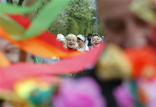 Belarusians celebrate the pagan ceremonial Yurya, in the village of Pogost, some 250 km &#40;155 miles&#41; south of Minsk, Friday, May 6, 2011. This annual traditional ceremony marking the pagan god Yurya is devoted to good future harvests. &#40;AP Photo&#47;Sergei Grits&#41; <span class=meta>(AP Photo&#47; Sergei Grits)</span>