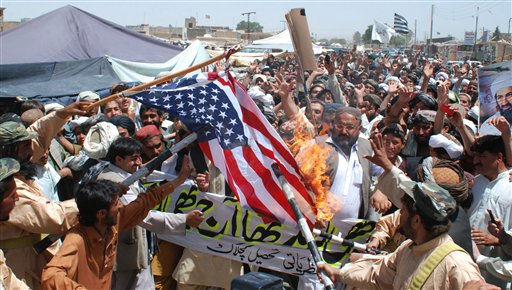Supporters of the Pakistani religious party Jamiat Ulema-e-Islam, burn a representation of a U. S. flag during a rally to condemn the killing of al-Qaida leader Osama bin Laden, in Kuchlak, 25 kilometers &#40;16 miles&#41; north of Quetta, Pakistan, Friday, May 6, 2011. One of three wives living with Osama bin Laden has told Pakistani interrogators she had been staying in the al-Qaida chief&#39;s hideout for six years without leaving its upper floors, a Pakistani intelligence official said Friday.&#40;AP Photo&#47;Arshad Butt&#41; <span class=meta>(AP Photo&#47; Arshad Butt)</span>