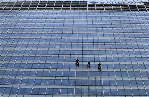 Workers clean the side of the One Churchill Place skyscraper, of which 32 floors serve as the headquarters of Barclays Bank, in the Canary Wharf business district of London, Friday, May 6, 2011.  &#40;AP Photo&#47;Matt Dunham&#41; <span class=meta>(AP Photo&#47; Matt Dunham)</span>