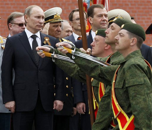 "<div class=""meta ""><span class=""caption-text "">Russian President Dmitry Medvedev, backgorund right, and Prime Minister Vladimir Putin, background left,  attends a wreath laying ceremony at the Tomb of Unknown Soldier on the eve of Victory Day in Moscow, Russia, Sunday, May 8, 2011. (AP Photo/RIA Novosti, Dmitry Astakhov, Presidential Press Service) (AP Photo/ Dmitry Astakhov)</span></div>"
