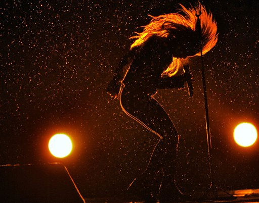 "<div class=""meta ""><span class=""caption-text "">Colombia's star singer Shakira performs in torrential rain during ""The Sun Comes Out World Tour"" concert in Bucharest, Romania, Saturday night, May 7, 2011. Thousands of fans braved heavy rain and low temperatures to attend the concert.(AP Photo/Vadim Ghirda) (AP Photo/ Vadim Ghirda)</span></div>"