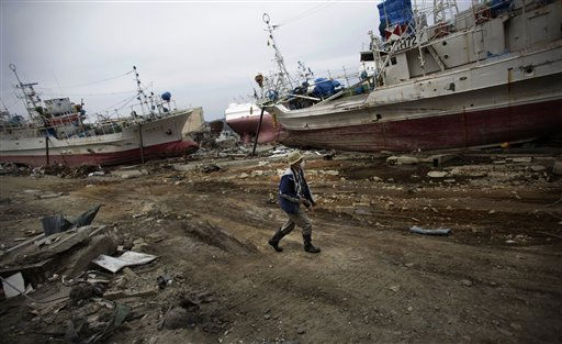 A man walks down a road past fishing boats washed ashore in an area destroyed by the March 11 earthquake and tsunami in Kesennuma, Miyagi Prefecture, northeastern Japan, Monday, May 9, 2011. &#40;AP Photo&#47;Junji Kurokawa&#41; <span class=meta>(AP Photo&#47; Junji Kurokawa)</span>