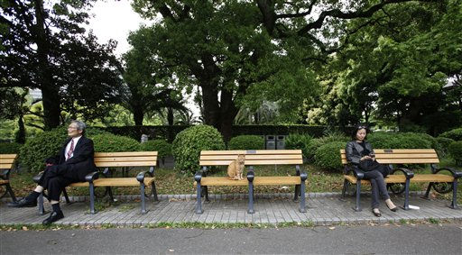 "<div class=""meta ""><span class=""caption-text "">People and a cat take a rest on benches at a park in Tokyo, Monday, May 9, 2011. (AP Photo/Shizuo Kambayashi) (AP Photo/ Shizuo Kambayashi)</span></div>"