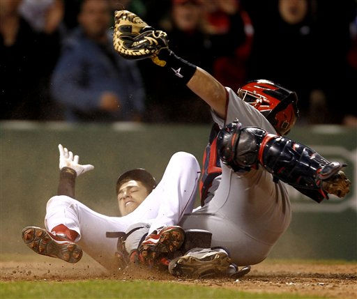 "<div class=""meta ""><span class=""caption-text "">Boston Red Sox's Jose Inglesias slides in safely with the game-winning run as Minnesota Twins catcher Rene Rivera holds up his glove in Boston's 2-1 win in 11 innings in a baseball game at Fenway Park in Boston on Monday, May 9, 2011. (AP Photo/Winslow Townson) (AP Photo/ Winslow Townson)</span></div>"