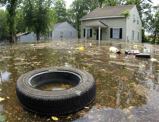 Trash floats by flooded homes on Monday, May 9, 2011, in Memphis, Tenn. The swollen Mississippi River could crest as early as Monday night. &#40;AP Photo&#47;Mark Humphrey&#41; <span class=meta>(AP Photo&#47; Mark Humphrey)</span>