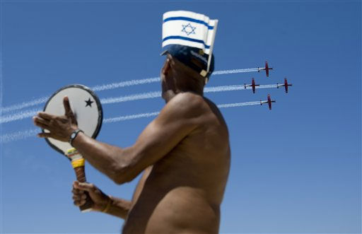 "<div class=""meta image-caption""><div class=""origin-logo origin-image ""><span></span></div><span class=""caption-text"">An Israeli man with a flag on his hat watches as Israeli air force acrobat planes fly over the Mediterranean sea, part of a flyover, during Israel's 63rd Independence Day celebrations  in Tel Aviv, Israel, Tuesday, May 10, 2011.  Israelis are celebrating Independence Day, marking the 63rd anniversary of the creation of the state of Israel. (AP Photo/Ariel Schalit) (AP Photo/ Ariel Schalit)</span></div>"