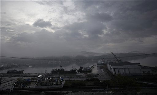 "<div class=""meta ""><span class=""caption-text "">Cloud covers a fishing port destroyed by the March 11 earthquake and tsunami in Kesennuma, northeastern Japan, Tuesday, May 10, 2011. (AP Photo/Junji Kurokawa) (AP Photo/ Junji Kurokawa)</span></div>"