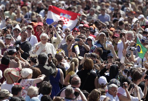 Pope Benedict XVI waves as he is driven through the crowd during his weekly general audience in St. Peter&#39;s Square, at the Vatican, Wednesday, May 11, 2011. &#40;AP Photo&#47;Pier Paolo Cito&#41; <span class=meta>(AP Photo&#47; Pier Paolo Cito)</span>