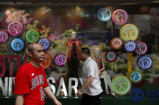 People walk past some window displays outside a department store on a downtown street in Hong Kong, Wednesday, May 11, 2011. &#40;AP Photo&#47;Vincent Yu&#41; <span class=meta>(AP Photo&#47; Vincent Yu)</span>