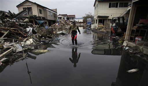 A Japan Ground Self Defense Force soldier walks through a flooded path in a port area hard hit by the March 11 earthquake and tsunami in Kesennuma, Miyagi Prefecture, northeastern Japan, Wednesday, May 11, 2011. &#40;AP Photo&#47;Junji Kurokawa&#41; <span class=meta>(AP Photo&#47; Junji Kurokawa)</span>
