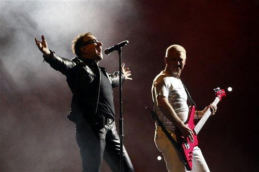 Members of the Irish rock band U2, Bono, left, and Adam Clayton perform during the band&#39;s 360 world tour at the Azteca stadium in Mexico City, Wednesday, May 11, 2011. &#40;AP Photo&#47;Alexandre Meneghini&#41; <span class=meta>(AP Photo&#47; Alexandre Meneghini)</span>