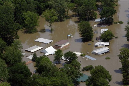 Houses and property along the Mississippi River near Tunica, Miss., are flooded by the Mississippi River, Wednesday, May 11, 2011.  Gov. Haley Barbour and other officials took an aerial trip along the Mississippi River and some of its tributaries to view the spreading damage from the flood waters. &#40;AP Photo&#47;Rogelio V. Solis&#41; <span class=meta>(AP Photo&#47; Rogelio V. Solis)</span>