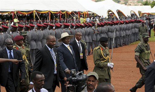 "<div class=""meta ""><span class=""caption-text "">Ugandan President Yoweri Museveni, center in a hat, inspects a guard after being sworn in as President at Kololo Airstrip in the capital city of Kampala Thursday, May 12, 2011. Uganda's top opposition leader flew back home Thursday and was welcomed by large crowds on the same day that the country's 25-year leader was sworn in to a fourth term.(AP Photo/Stephen Wandera) (AP Photo/ Stephen Wandera)</span></div>"