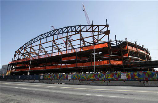 "<div class=""meta ""><span class=""caption-text "">Construction continues along the Atlantic Avenue side of the Barclays Center, a new basketball arena, that is part of Brooklyn's Altantic Yards redevelopment project, Thursday, May 12, 2011, in New York.  The 675,000 square-foot arena, which will be home to the NBA Nets, is scheduled to open in the fall of 2012. (AP Photo/Kathy Willens) (AP Photo/ Kathy Willens)</span></div>"