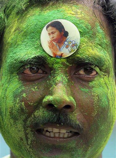 "<div class=""meta image-caption""><div class=""origin-logo origin-image ""><span></span></div><span class=""caption-text"">A Trinamool Congress party supporter, his face smeared with colored powder, wears party leader Mamata Banerjee's badge on his forehead as he celebrates the early leads, outside her residence in Kolkata, India, Friday, May 13, 2011. Counting of votes began Friday in India's fourth most-populous state of West Bengal, where India's ruling Congress and its ally Trinamool Congress were predicted to unseat a Communist-led government that has held power for 34 years. (AP Photo/Sucheta Das) (AP Photo/ Sucheta Das)</span></div>"