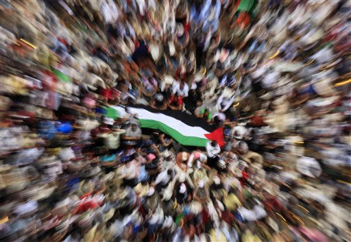 Egyptians gather  around a Palestinian flag during a protest against Israel&#39;s closure of Gaza at Tahrir Square, the focal point of Egyptian uprising, in Cairo, Egypt, Friday, May 13, 2011. &#40;AP Photo&#47;Amr Nabil&#41; <span class=meta>(AP Photo&#47; Amr Nabil)</span>