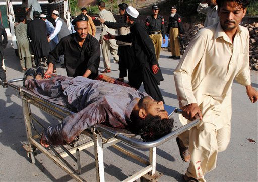 "<div class=""meta ""><span class=""caption-text "">People rush a man injured in twin suicide bombs attacks to a local hospital in Peshawar, Pakistan on Friday, May 13, 2011. Twin explosions struck a paramilitary training center in northwestern Pakistan on Friday, in the bloodiest attack in the country since a U.S. raid killed al-Qaida chief Osama bin Laden. (AP Photo/Mohammad Zubair) (AP Photo/ Mohammad Zubair)</span></div>"