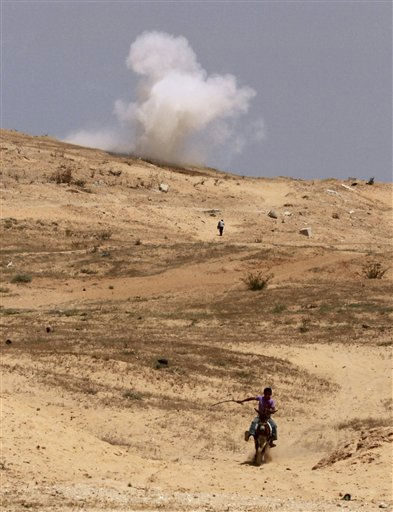 "<div class=""meta ""><span class=""caption-text "">Smoke rises after an Israeli tank shell hit an area near Erez Crossing as Palestinians marked the 63rd anniversary of ""Nakba"", Arabic for ""Catastrophe"", the term used to mark the events leading to Israel's founding in 1948, at Erez crossing between Israel and northern Gaza, Sunday, May 15, 2011. Israeli troops clashed with Arab protesters along two hostile borders on Sunday, leaving as many as five people dead and dozens wounded as the Palestinians commemorated their mass displacement during the war surrounding Israel's establishment in 1948.( AP Photo/Hatem Moussa) (AP Photo/ Hatem Moussa)</span></div>"