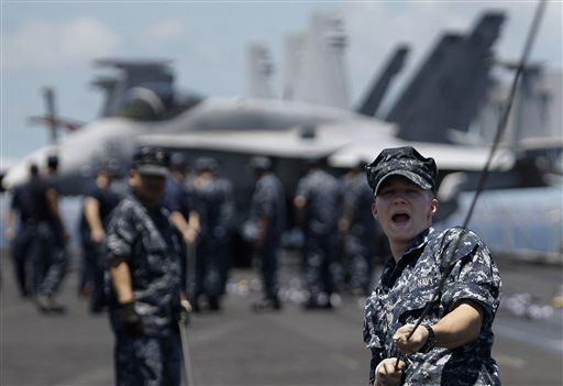 "<div class=""meta ""><span class=""caption-text "">A U.S. Navy man pulls a cord on the tarmac of the U.S. aircraft carrier USS Carl Vinson at Manila Bay, Philippines, as it begins its four-day goodwill visit with three other warships on Sunday May 15, 2011. U.S. officials welcomed visitors Sunday to the USS Carl Vinson warship, from which Osama bin Laden's body was buried at sea, but did not discuss the ultra-secretive attack that killed him, reflecting America's concern over possible retaliation. (AP Photo/Aaron Favila) (AP Photo/ Aaron Favila)</span></div>"