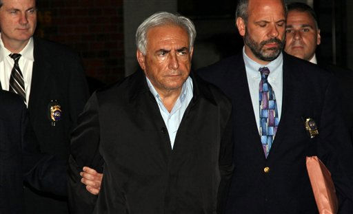 Dominique Strauss-Kahn, head of the International Monetary Fund, is lead from a police station Sunday, May 15, 2011 in New York where he was being held. Strauss-Kahn, a possible candidate for president of France, was pulled from an airplane moments before it was to depart for Paris on Saturday, and arrested in the alleged sexual assault of a New York hotel maid, police said. &#40;AP Photo&#47;Craig Ruttle&#41; <span class=meta>(AP Photo&#47; Craig Ruttle)</span>