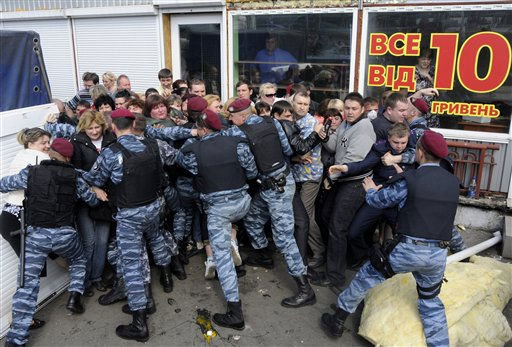 Policemen prevent traders from entering an outdoors market in Kiev, Ukraine, Monday, May 16, 2011. Authorities on Monday sought to dismantle the local market in Kiev in an attempt to improve trade regulations.&#40;AP Photo&#47;Sergei Chuzavkov&#41; <span class=meta>(AP Photo&#47; Sergei Chuzavkov)</span>