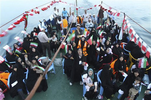 This picture released by the semi-official Iranian Mehr News Agency on Tuesday, May 17, 2011, shows Iranian activists chanting slogans aboard a ship in the Persian Gulf, Iran, carrying Iranian activists towards Bahrain.  On Monday, May 16, two ships carrying 120 Iranian hard-line activists left for Bahrain, part of an effort to show solidarity with the Shiite majority population of the tiny island nation. &#40;AP Photo&#47;Mehr News Agency, Mohsen Norouzi Fard&#41; <span class=meta>(AP Photo&#47; Mohsen Norouzi Fard)</span>