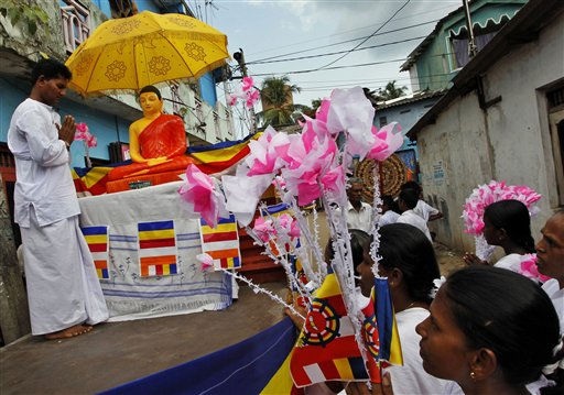 "<div class=""meta ""><span class=""caption-text "">Sri Lankan Buddhist devotees carry a statue of Lord Buddha during the religious week coinciding with Buddha Poornima in Colombo, Sri Lanka, Tuesday, May 17, 2011. This year Buddhists mark the 2600th anniversary of the enlightenment of Buddha. (AP Photo/Eranga Jayawardena) (AP Photo/ Eranga Jayawardena)</span></div>"