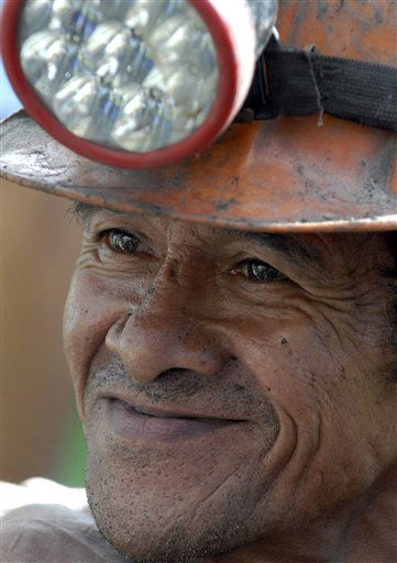 Miner Uriel Angel Villegas, 58, smiles after being rescued from the Loma Gorda caved-in coal mine in Montebello, southern Colombia, Tuesday, May 17, 2011. Emergency crews rescued eight miners who had spent six hours trapped in the mine. &#40;AP Photo&#47;Carlos Julio Martinez&#41; <span class=meta>(AP Photo&#47; Carlos Julio Mart?nez)</span>