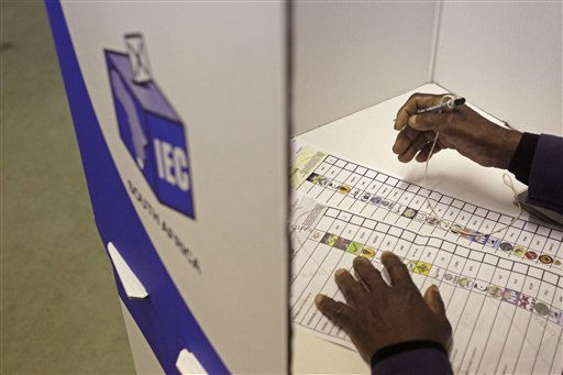 "<div class=""meta image-caption""><div class=""origin-logo origin-image ""><span></span></div><span class=""caption-text"">A woman studies the ballot paper before making her mark to cast her vote in local municipality elections, in a township on the outskirts of Cape Town, South Africa, Wednesday, May 18, 2011.  Some 23 million voters were registered at 20,000 polling stations across this country, and the results are likely to have an impact on national politics.  (AP Photo/Schalk van Zuydam) (AP Photo/ Schalk van Zuydam)</span></div>"