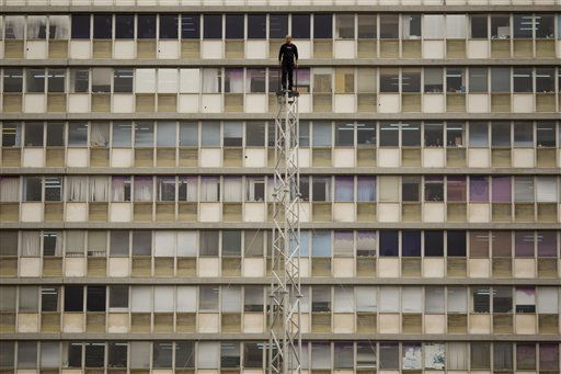 "<div class=""meta image-caption""><div class=""origin-logo origin-image ""><span></span></div><span class=""caption-text"">Back-dropped by the building of the Tel Aviv municipality, Israeli illusionist and endurance artist Hezi Dean stands atop of a tower where he intends to remain for 35 hours, at Rabin square in Tel Aviv, Israel, Wednesday, May 18, 2011.  Dean started his most recent stunt Wednesday in an attempt to break the record of American illusionist and endurance artist David Blaine. Dean was raised on the 27-meters high tower Wednesday morning and aims to remain there with no food until Thursday evening, for a total of 35-hours. (AP Photo/Ariel Schalit) (AP Photo/ Ariel Schalit)</span></div>"