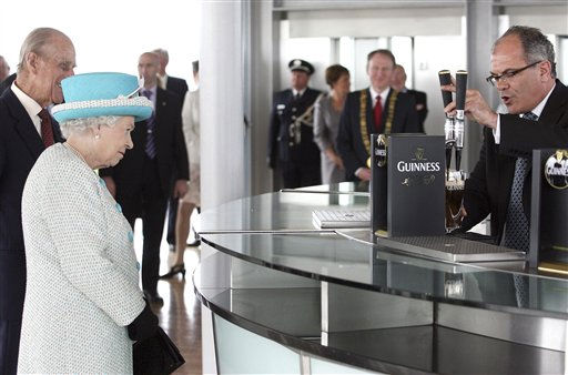 Britain&#39;s Queen Elizabeth II and Prince Philip watch as Fergal Murray pours a pint of Guinness in  the Gravity Bar, during a tour of the Guinness Storehouse, one of Ireland&#39;s most popular sites, in Dublin, Wednesday May 18, 2011. Both the Queen and Prince Philip, on the second day of the first-ever state visit to Ireland, declined to taste the Irish stout.&#40;AP Photo&#47;pool&#41; <span class=meta>(AP Photo&#47; Anonymous)</span>