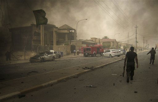 "<div class=""meta ""><span class=""caption-text "">Iraqi security forces inspect the scene of a bombing in Kirkuk, 180 miles, or 290 kilometers, north of Baghdad, Iraq, Thursday, May 19, 2011. Twin bombs that appeared timed to lure policemen out of their fortified headquarters killed and wounded dozens of policemen. (AP Photo/Emad Matti) (AP Photo/ Emad Matti)</span></div>"