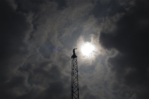 "<div class=""meta ""><span class=""caption-text "">Israeli illusionist and endurance artist Hezi Dean stands atop of a tower where he intends to remain for 35 hours, at Rabin square in Tel Aviv, Israel, Thursday, May 19, 2011. Dean started his most recent stunt Wednesday in an attempt to break the record of American illusionist and endurance artist David Blaine. Dean was raised on the 27-meters high tower Wednesday morning and aims to remain there with no food until Thursday evening, for a total of 35-hours. (AP Photo/Ariel Schalit) (AP Photo/ Ariel Schalit)</span></div>"